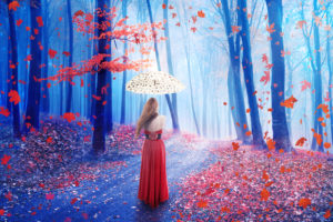 Fantasy image of a beautiful lonely young woman with umbrella walking in a forest in fairy and dreamy realm. Nature background