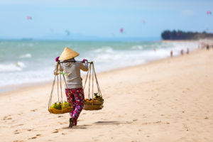 Vietnamese woman selling Fruits at Mui Ne beach. Vietnam. Asia