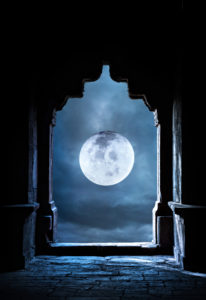 Arch silhouette in old temple at night sky with full moon premade background